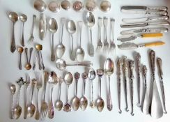A miscellany of silver flatware to include souvenir spoons, forks, knives, button hooks, bottle