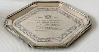 An Art Deco silver octagonal presentation tray with shaped rim and isometric border decoration to