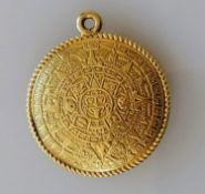 A highly decorated Aztec-style gold pendant, 30mm diameter, stamped 18K, 15.21g
