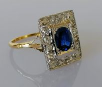 An Art Deco oval-cut sapphire and diamond cluster ring on an 18ct yellow gold setting: the