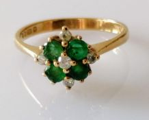 An emerald and diamond cluster ring: estimated total emerald weight 0.45 carats, diamonds 0.12