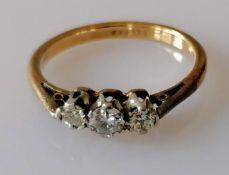 A vintage three-stone diamond ring, with graduated brilliant-cut diamonds, estimated total 0.25