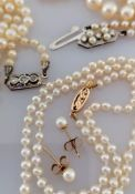 A mid-century choker string of pearls with gold clasp, stamped 15ct and a closely matching pair of