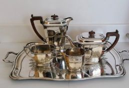 An Art Deco silver four-piece tea/coffee service with egg and dart decoration to rim, faceted sides,