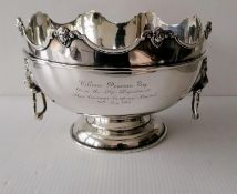 A George V silver monteith with shaped rim, carved mask decoration, moulded girdle, flanked by