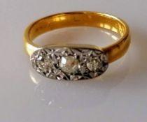 A three-stone pave-set diamond ring comprising three brilliant-cut diamonds, one measuring