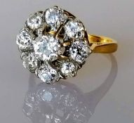 A diamond cluster ring on a claw-set yellow and white 18ct gold setting: the central old European-