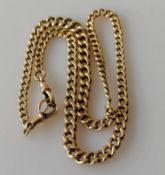 An Edwardian graduated gold curb-link Albert chain with two clasps, each stamped 9/375, maker's mark