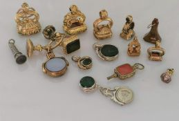 An assortment of eighteen fobs, many carnelian, some bloodstone with carved names, insignia, etc