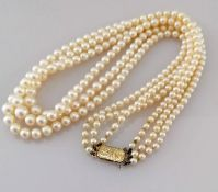 A mid-century three-strand graduated Akoya pearl necklet comprising ninety-one, ninety-five, and 103