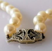 An Art Deco single row of fifty-one graduated cultured pearls measuring approx. 7.96mm to 10.35mm