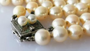 A two-row necklet of one hundred and seventy-three (89, 84) uniform cultured pearls, 6mm to 6.6mm on