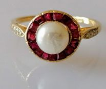 A vintage pearl, ruby and diamond ring, with a central 6mm pearl, surrounded by calibre-cut rubies