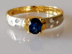 A mid-century oval mixed-cut sapphire gold ring, the sapphire measuring 5.04mm x 4.02mm x 2.48mm,