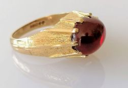 A mid-century 9ct gold gypsy ring with garnet cabochon, size R, hallmarked, 6.07g