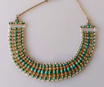 An early 20th century turquoise, old-cut diamond and seed pearl bib necklace on a gold honeycomb