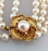 A three row, two-hundred and thirteen cultured pearl necklace, each measuring av. 4.95mm on a 9ct