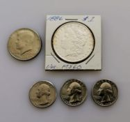 An 1886 Morgan one dollar coin, graded MS-60; three 1776-1976 quarter dollar coins, Denver mint