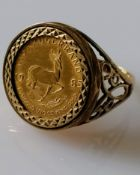 A 1/10th Krugerrand coin, 1985, on a pierced 9ct gold mount, size O, hallmarked, 6.09g