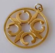 A 9ct yellow gold carved pendant, 36mm diameter, hallmarked, 8.12g