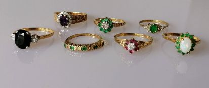 An assortment of seven 9ct gold gem-set rings, various sizes, all hallmarked, 11.88g