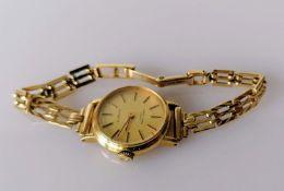 A 9ct gold-cased mid-century Favre-Leuba quartz ladies dress watch with champagne dial, baton