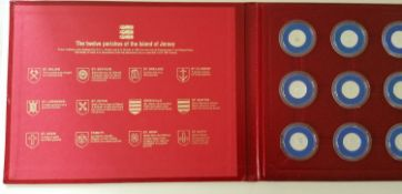 A set of twelve Jersey £1 coins commemorating each of the twelve parishes of Jersey, each in a