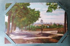 An assortment of Edwardian greeting cards and later topographical postcards of British towns/