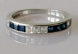 An 18ct white gold half-hoop sapphire and diamond eternity ring, channel-set with six square-cut