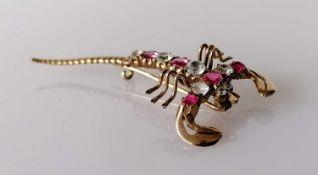 A ruby and diamond scorpion brooch on a gold base, 5.5 cm, unmarked, approximately 0.60 carats total