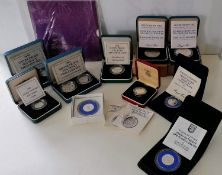 An assortment of commemorative coins to include: the Royal Mint Golden Jubilee Five Pounds Crown