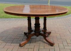 A late Victorian Gillows oval burr walnut centre table with crossbanding and decorative inlay on a