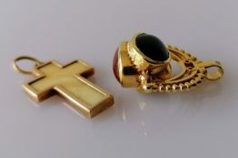 A 9ct gold oval jade, carnelian and black onyx swivel fob pendant, hallmarked and a yellow gold