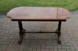 A mid-19th century burr walnut writing or library table with inlay decoration, plain frieze, bow