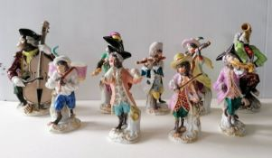 A Meissen monkey band comprising seven monkeys in 18th century costume each standing on a scroll