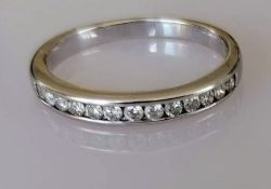 A diamond half-hoop eternity ring, the 18ct white gold band set with thirteen round brilliant-cut