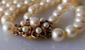 A knotted two-row cultured rope necklet with 109 and 104 approximately, 7mm pearls united by a 9ct