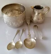 A Victorian Anglo-Indian silver embossed bowl (8.5 h x 11 cm diameter) and creamer (8.5 cm H) by