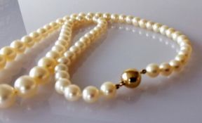 A mid-century single row of sixty-nine graduated Akoya cultured pearls measuring 6mm to 9.7mm with