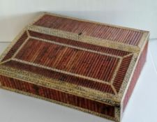 A 19th century Anglo-Indian Vizagapatam and porcupine quill writing slope with hinged cover and
