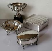 A George V oval silver trinket box with fabric-lined interior on four hoof feet by Sydney & Co.,