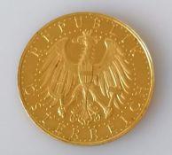 An Austrian 1929 First Republic 100 schilling gold coin, 23.56g