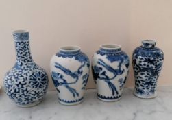 A pair of late 19th century/early 20th century blue and white baluster vases, each 12.5 cm H (one
