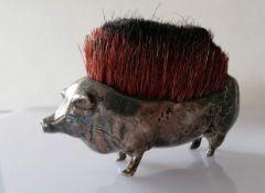 An Edwardian silver nib brush in the form of a pig, Birmingham, 1906, maker's mark rubbed, 11 cm