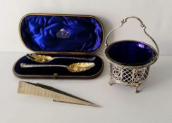 A cased pair of George II silver berry spoon by Benjamin Cartwright II, London, 1759, both