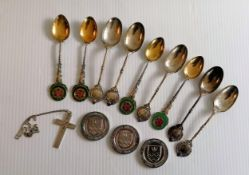 A selection of silver presentation teaspoons, three silver medals, a silver bangle and a crucifix