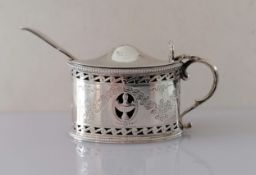 An Edwardian silver oval mustard pot with beaded borders, pierced body, bright-cut floral swags