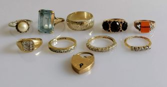 A selection of eight gold gem-set rings, a lock, all hallmarked 9ct, another ring not stamped,