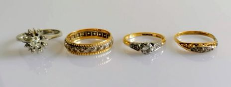 A white gold star-ring with diamond decoration; a white and yellow gold eternity ring; a gold and