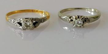 An early 20th century yellow gold and platinum diamond solitaire ring, round-cut diamond